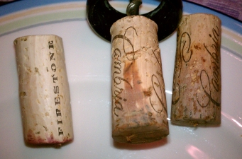 A classic example of corks showing bottle over heating. On the left, a cork as it should after opening. On right, two corks showing the wine's exposure to air. The corks on the right were from a Chardonnay bottle (thus the light color.)